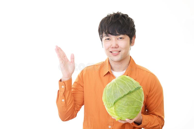 Asian man with vegetable. Smiling Asian man with vegetable stock images