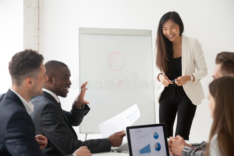Asian coach making presentation on flipchart for diverse work gr royalty free stock image