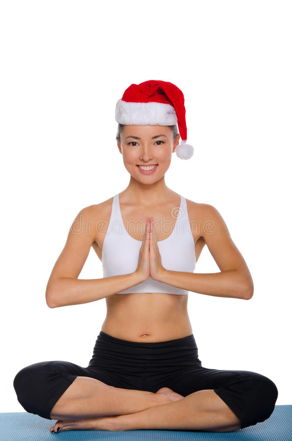Smiling asian in Santa Claus hat. Isolated on white royalty free stock photography
