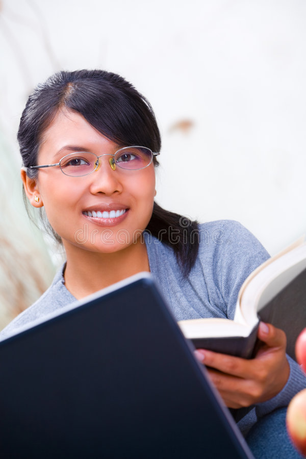Download Smiling Asian scholar stock photo. Image of college, hardcover - 8733184