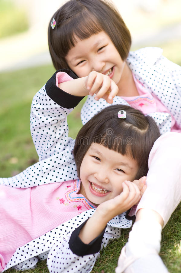 Free Smiling Asian Twin Girls Stock Photography - 12010472