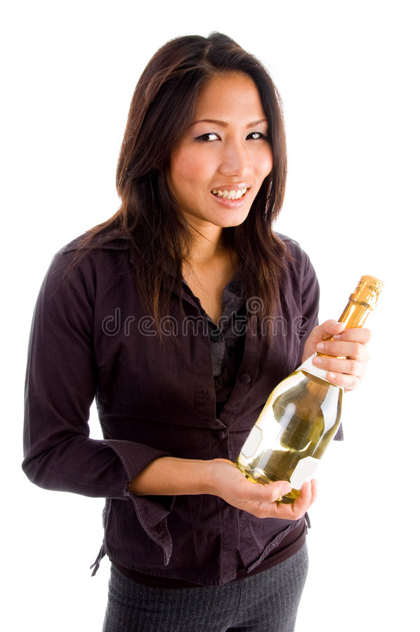 Smiling asian woman holding champagne bottle stock images