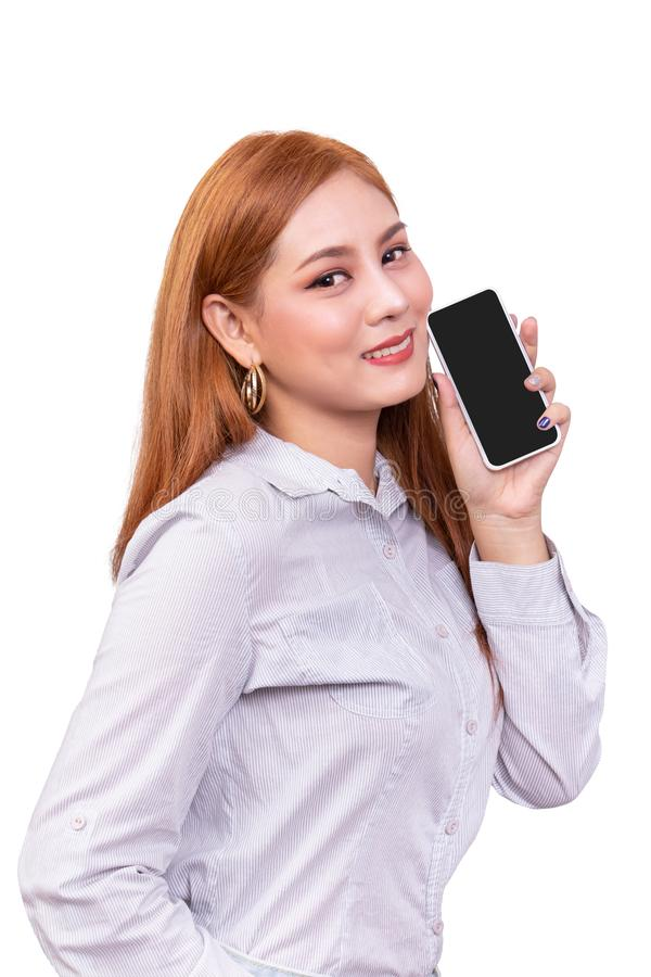 Smiling Asian woman holding mobile smartphone with blank black screen standing on white background , clipping path include stock image
