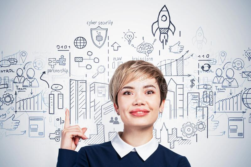 Smiling Asian woman pointing at startup sketch royalty free stock images