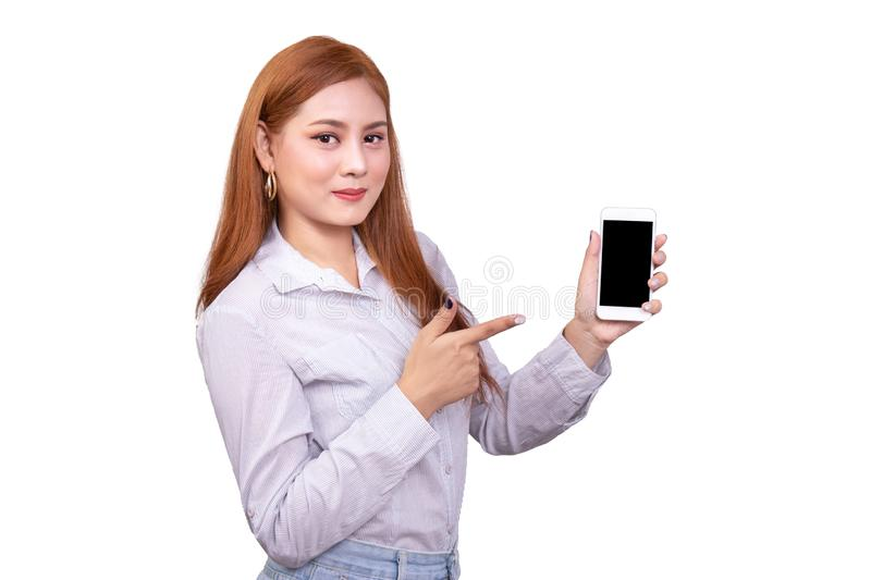 Smiling Asian woman standing in casual shirt holding mobile phone and  pointing on smartphone isolated on white background stock photos