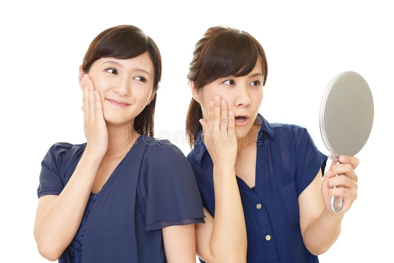 Smiling Asian women stock images