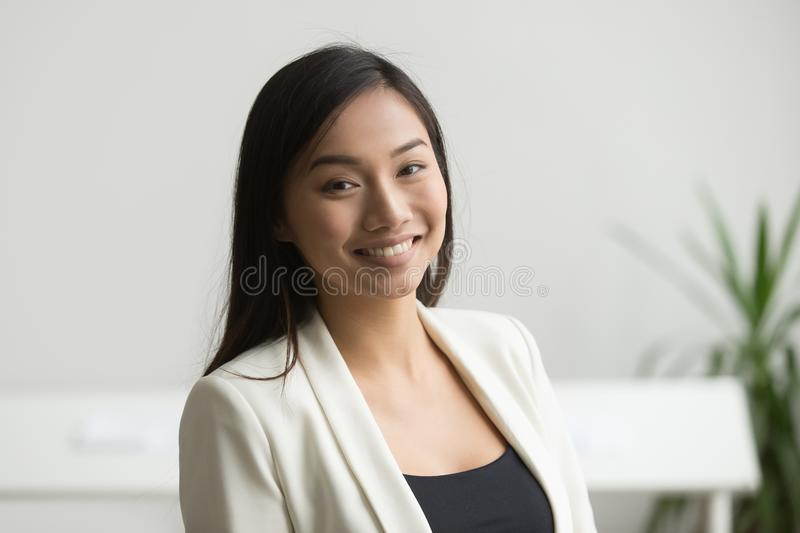 Smiling Asian worker posing to camera stock photos