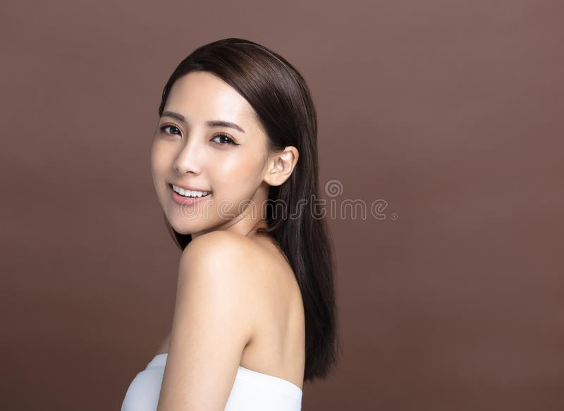 Smiling young woman with natural makeup and clean skin royalty free stock photography
