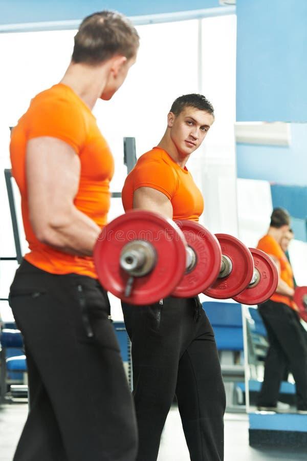 Bodybuilder Man Doing Biceps Muscle Exercises Stock Image