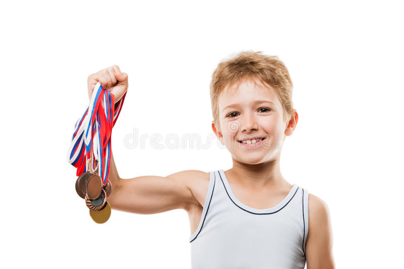 Smiling athlete champion child boy gesturing for victory triumph. Sport success and win concept - smiling athlete champion child boy hand holding first place royalty free stock photos