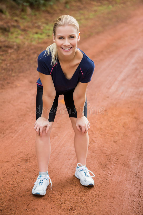 Smiling athletic blonde resting stock photo