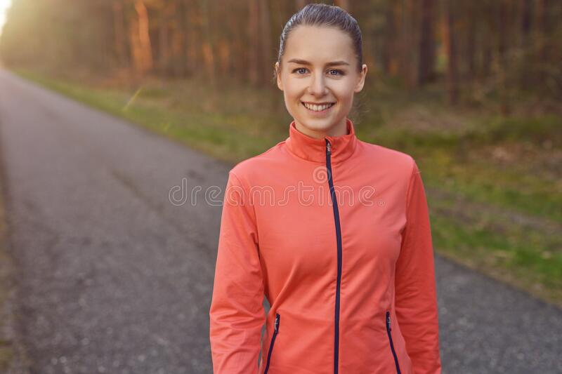 Smiling athletic fit young woman working out royalty free stock images