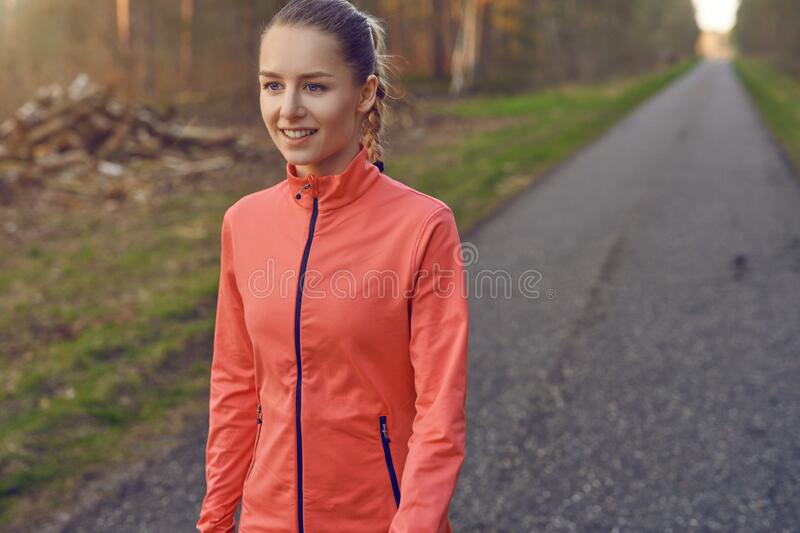 Smiling athletic fit young woman working out stock images