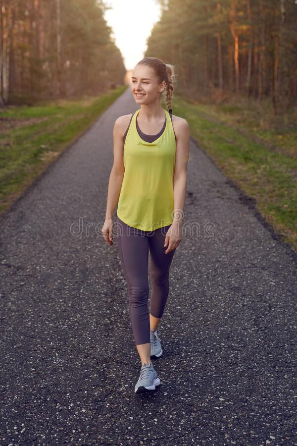 Smiling athletic fit young woman working out royalty free stock photo