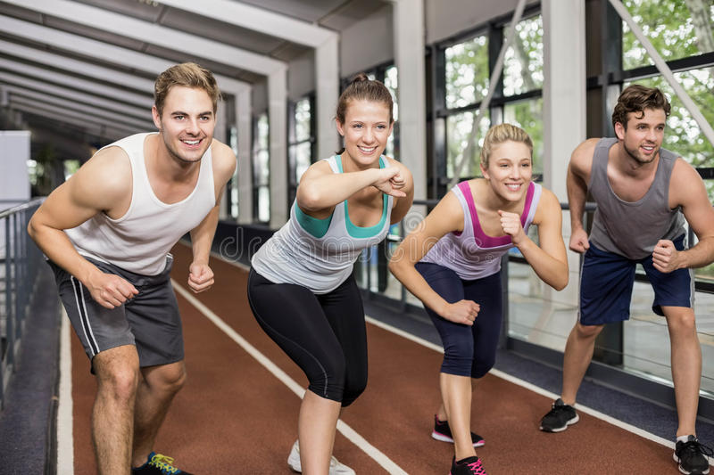 Smiling athletic friends going to start running stock photos
