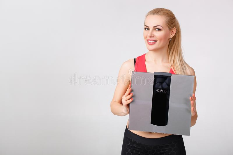 Woman holding scales in hands royalty free stock photo