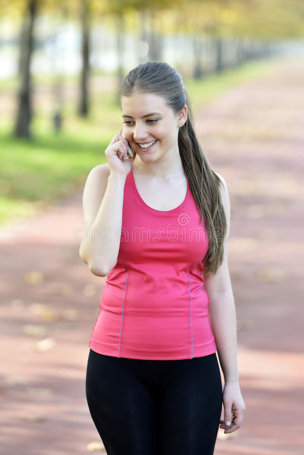 Smiling Athletic Woman Take A Rest After Training Stock Photos