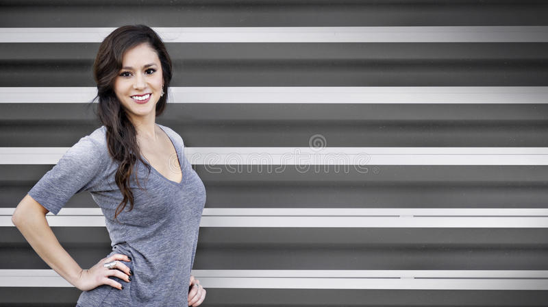 Smiling athletic young woman royalty free stock photography