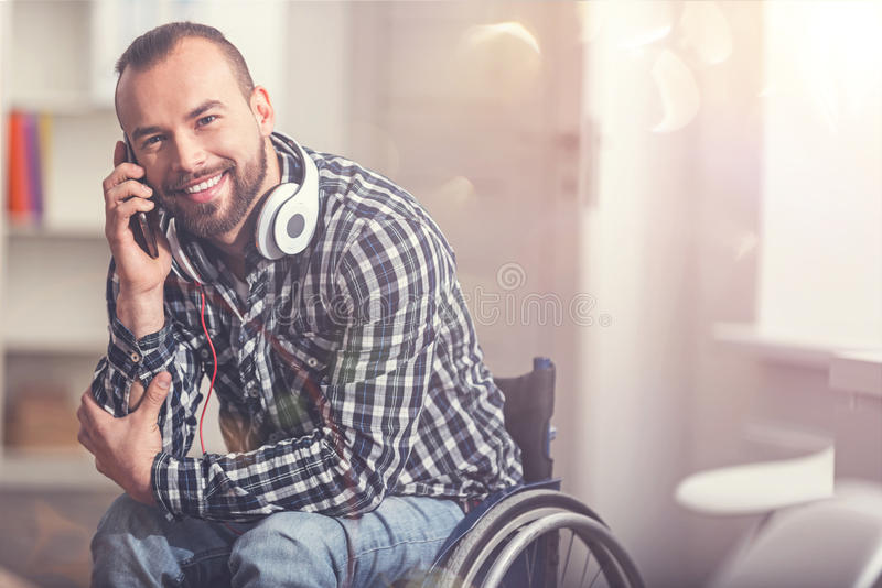 Smiling attractive man speaking on phone stock photo