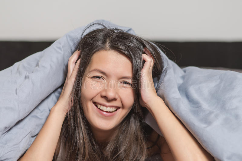 Smiling attractive woman enjoying a lazy day royalty free stock photo