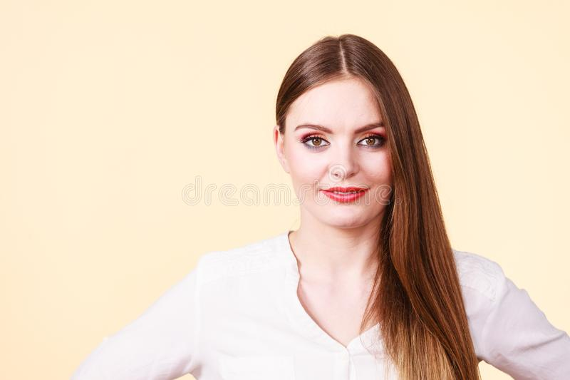Smiling attractive woman with full makeup stock image