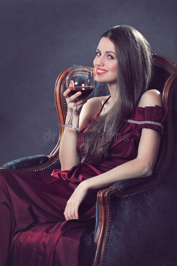Download Smiling Attractive Woman Poses With A Glass Of Red Wine Stock Photo - Image: 30035814