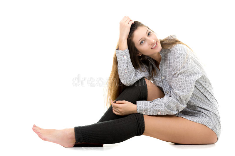 Smiling attractive young girl in shirt and gaiters stock images