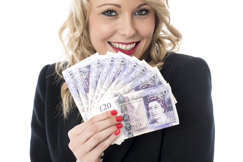 Smiling Attractive Young Woman Holding Money Sterling Pounds. Happy Smiling Attractive Young Woman Holding Money Sterling Pounds royalty free stock photos
