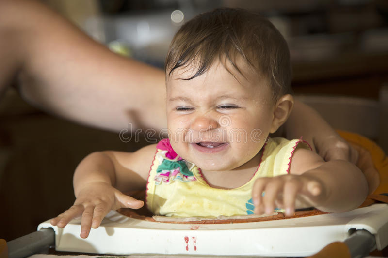 Smiling baby on baby chair royalty free stock photos