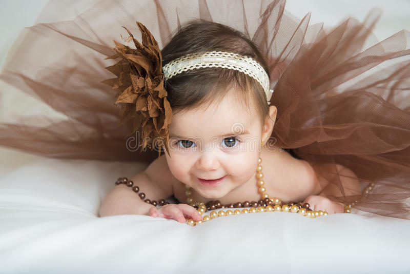Smiling baby ballerina in brown tutu stock photography
