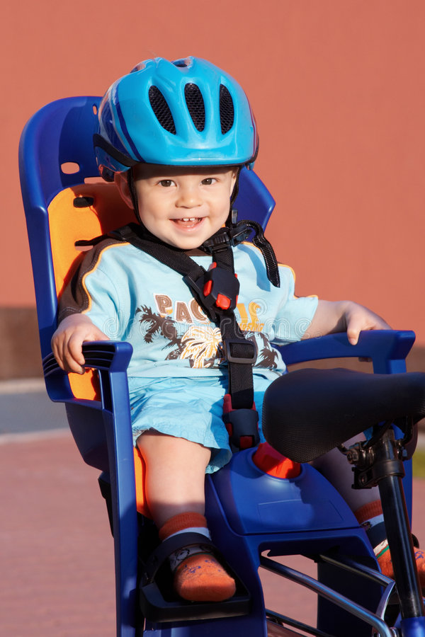 Download Smiling Baby In Bicycle Seat Stock Photo - Image of seat, chair: 5499240