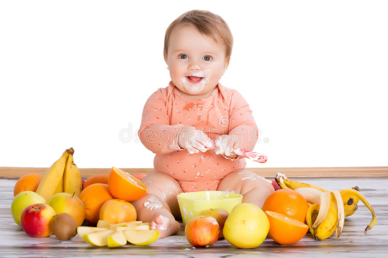 Smiling Baby And Fruits Stock Photo