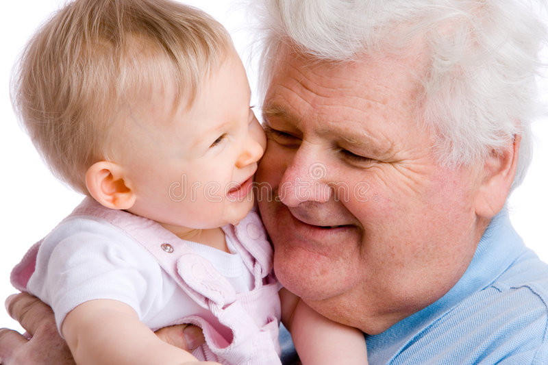 Smiling baby with gramps stock photography