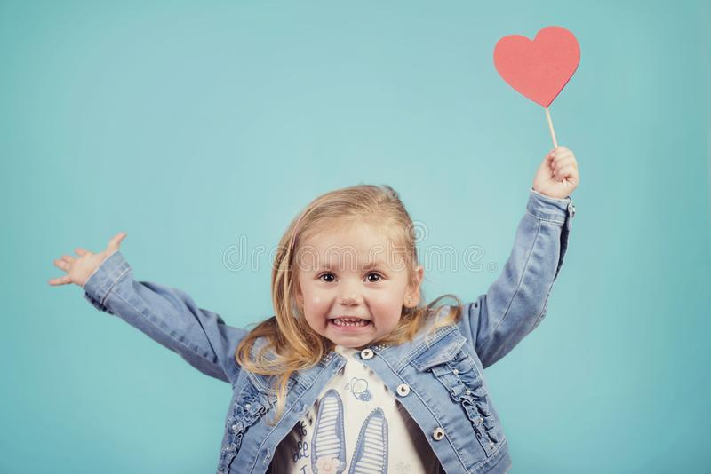 Smiling baby with a heart royalty free stock image