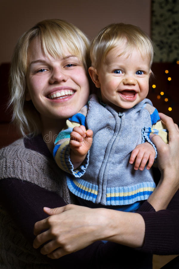 Smiling baby with mother stock image