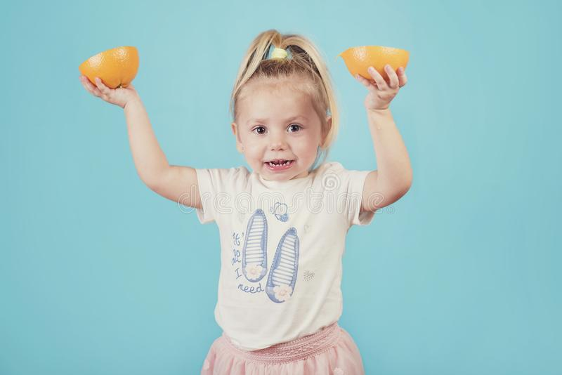 Smiling baby with an orange royalty free stock image