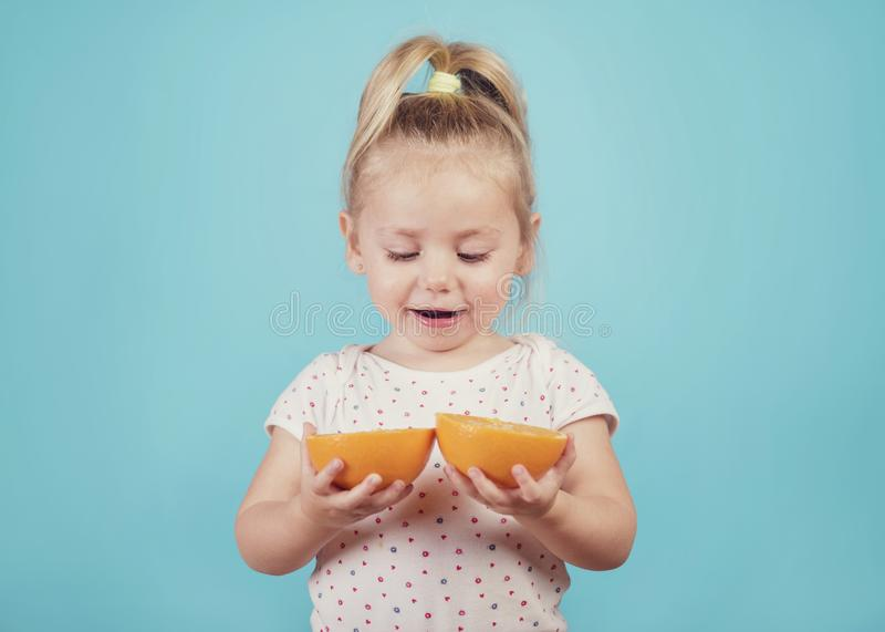 Smiling baby with an orange stock images