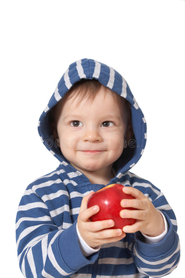 Smiling baby with red apple royalty free stock photo