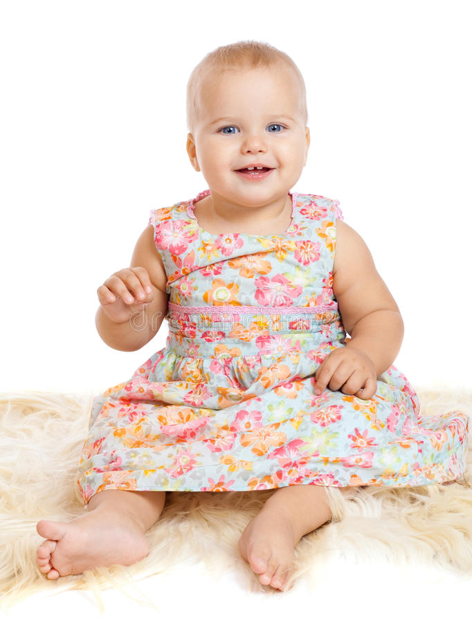 Download Smiling Baby Sitting On The Furry Rug Stock Photo - Image: 22223106