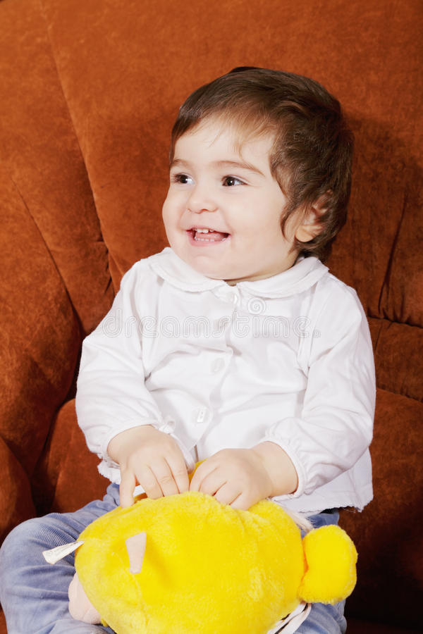 Smiling Baby With Soft Toy Stock Images