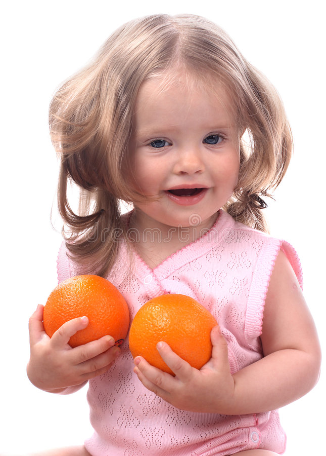 Smiling baby and two orange. royalty free stock image
