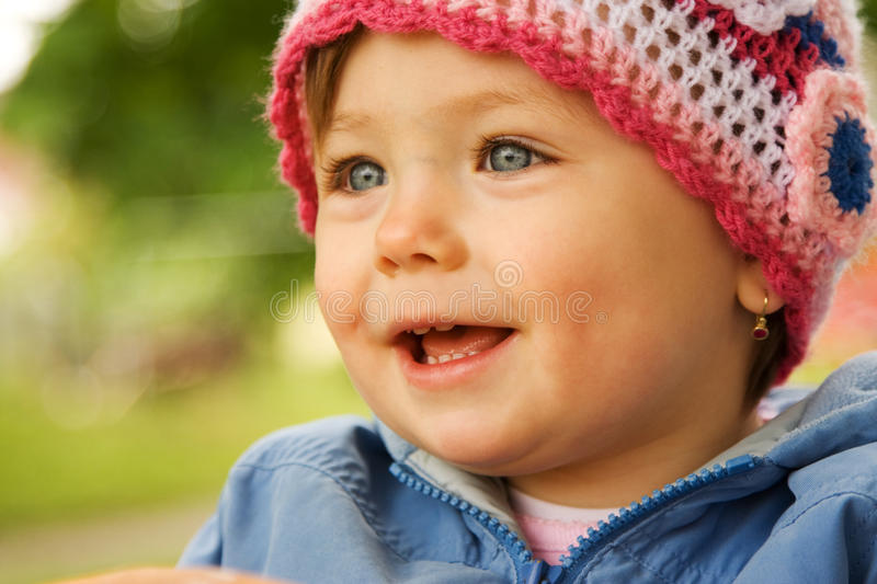 Smiling baby wearing hat stock images
