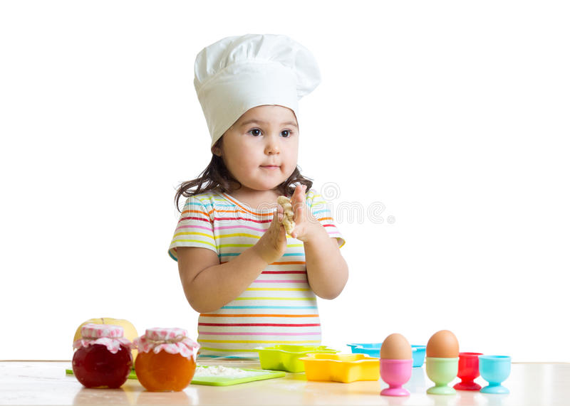 Smiling baker kid girl in chef hat royalty free stock photo