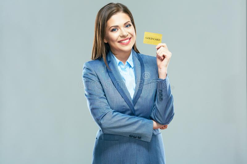 Smiling bank employee woman suit dressed show plastic credit ca royalty free stock images