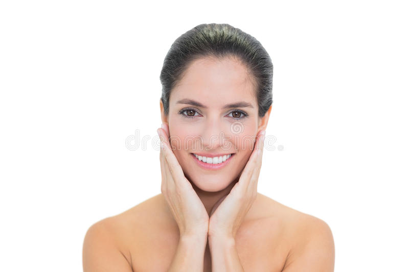Smiling Bare Brunette Touching Her Face Royalty Free Stock Photography
