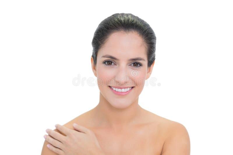 Smiling Bare Brunette Touching Left Shoulder Royalty Free Stock Image