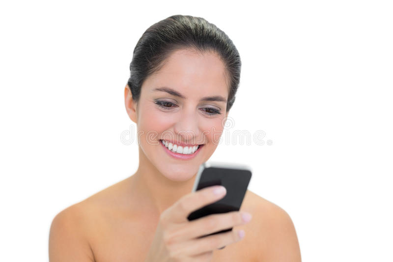 Download Smiling Bare Brunette Using Smartphone Stock Image - Image: 34397133