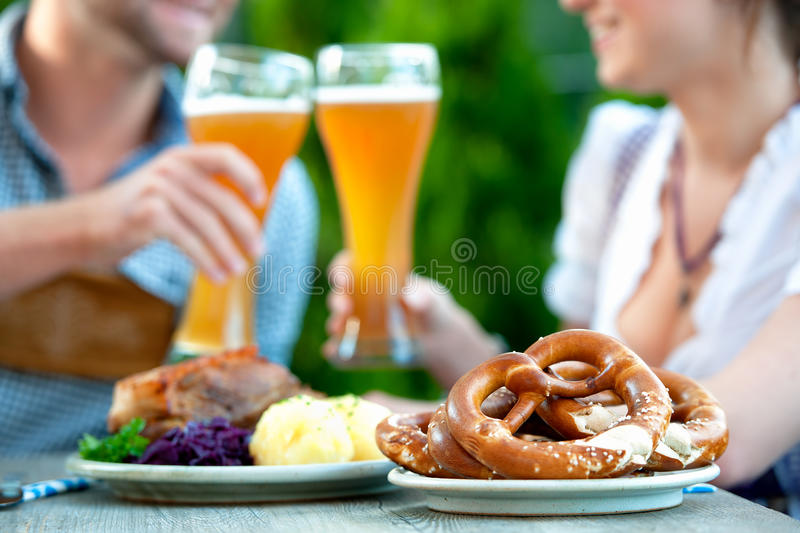 Smiling bavarian couple at Oktoberfest stock photo