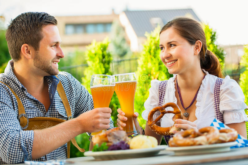 Smiling bavarian couple at Oktoberfest royalty free stock photos