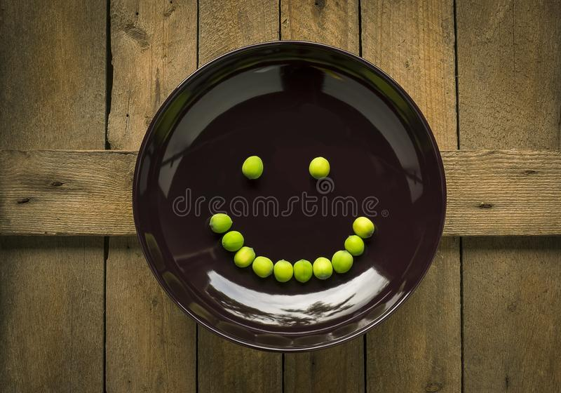 Smiling beans on plate royalty free stock photo